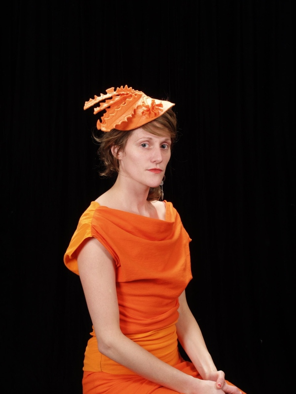 kimberley in orange hat